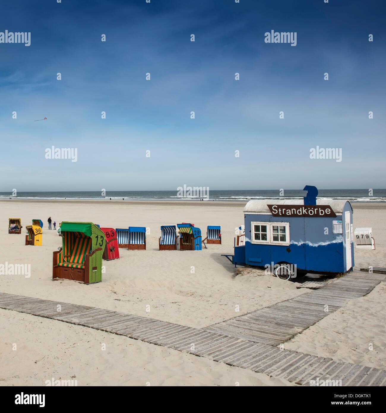 Roofed wicker beach chair rental on the beach, Juist island, North Sea, Lower Saxony - Stock Image