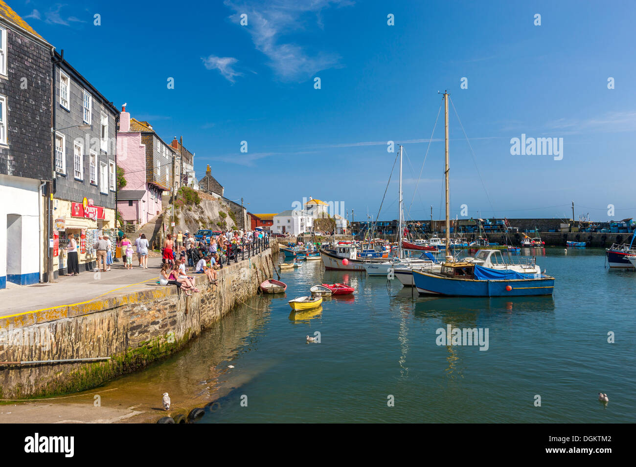 Old wooden fishing boats in the harbour at Mevagissey. - Stock Image