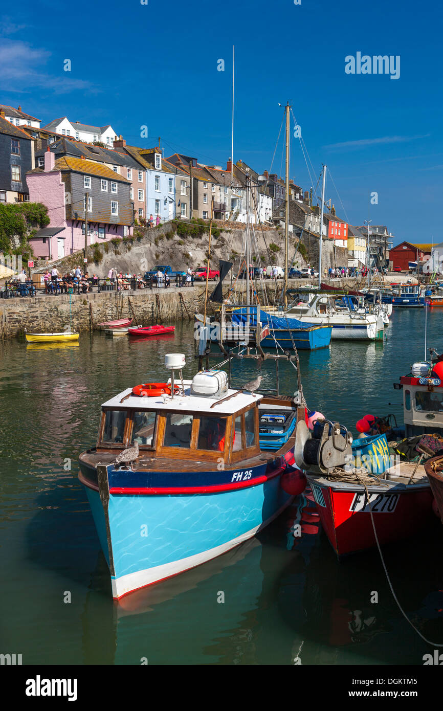 Old wooden fishing boats in the harbour. - Stock Image