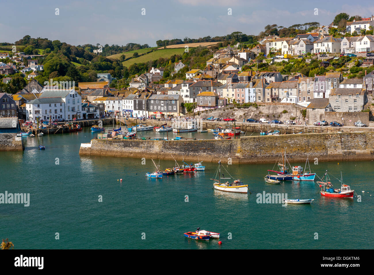 Houses on headland surrounding the old fishing port of Mevagissey. - Stock Image