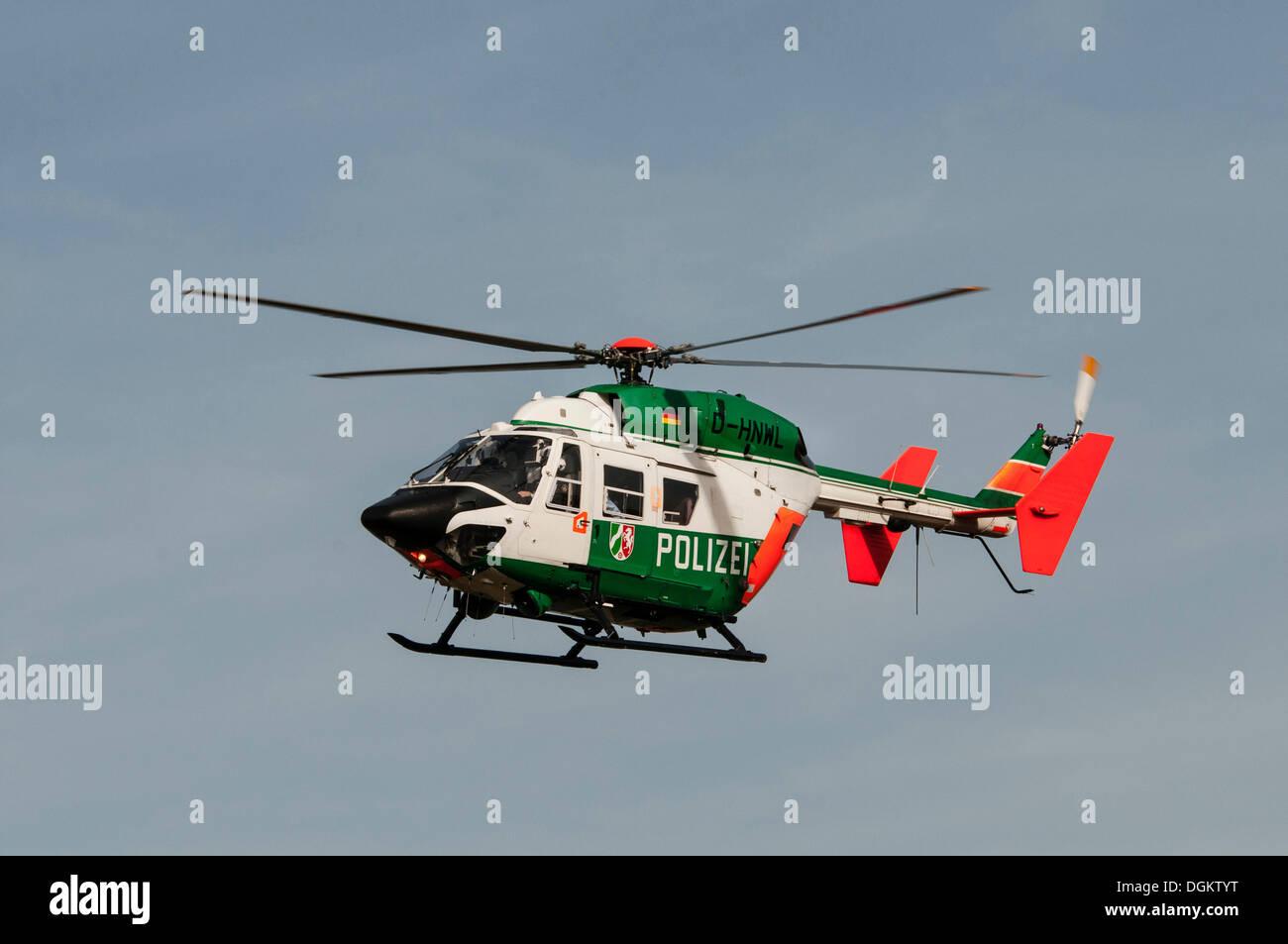 Police helicopter 'Hummel 9' in flight near Duesseldorf Airport, North Rhine-Westphalia - Stock Image