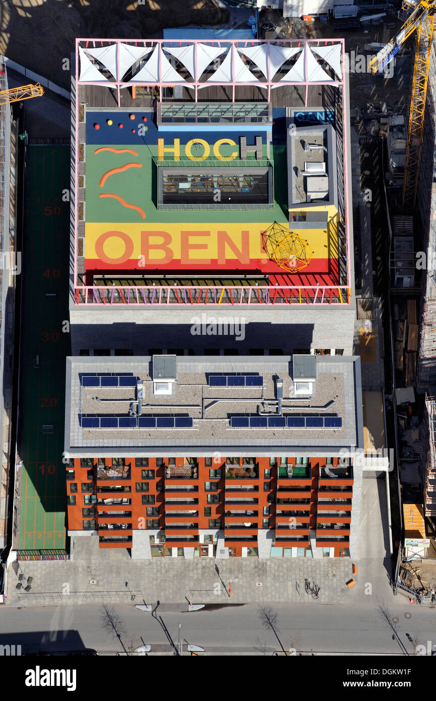 Aerial view, message 'Ganz hoch oben', German for 'very high up', on the roof of Katharinenschule primary school, daycare - Stock Image