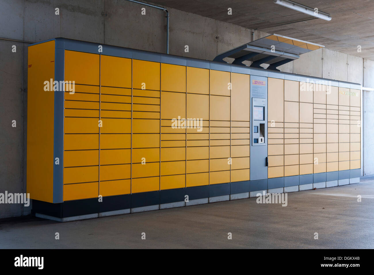 DHL Packstation, automated booths for self-service for collection and dispatch of parcels and oversize letters in Germany - Stock Image