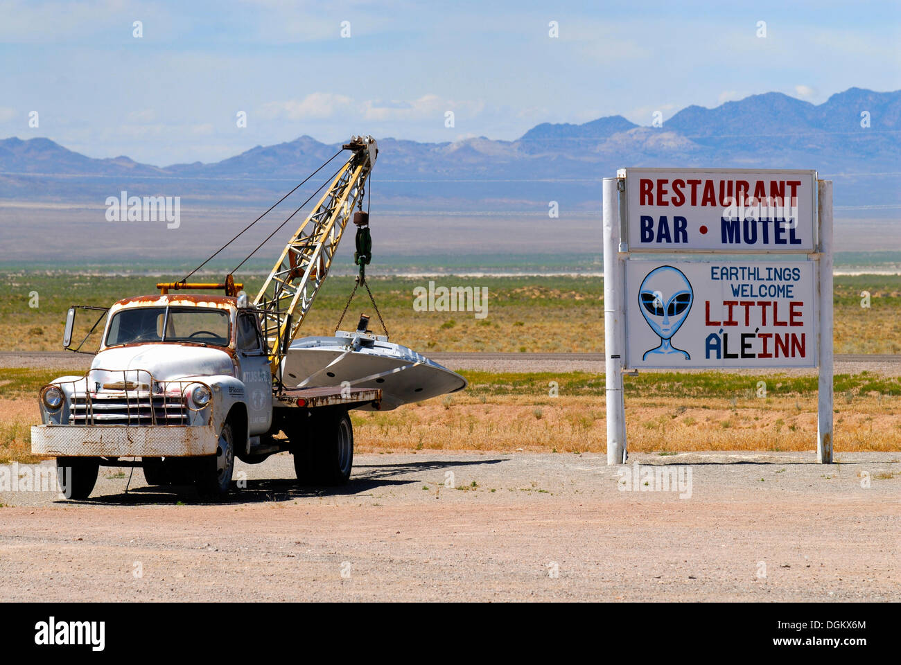 """UFO hanging on the tow hook in the car park of the """"Little A'Le'Inn"""" pub, Rachel, Rachel, Nevada, United States Stock Photo"""