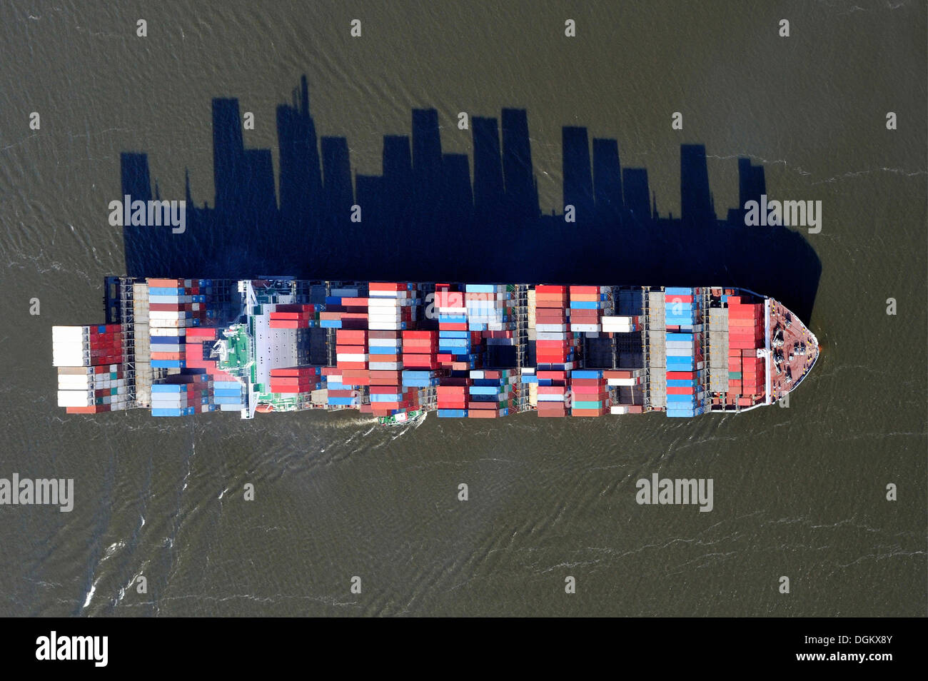 Aerial view, container ship on the Elbe River, with long shadows of the stacked containers, Hamburg, Hamburg, Germany Stock Photo