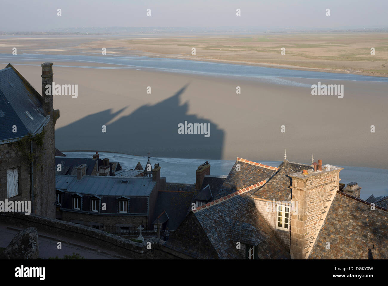 Roofs and shadow of Mont Saint-Michel, mud flats at low tide, Lower Normandy, France, Europe - Stock Image