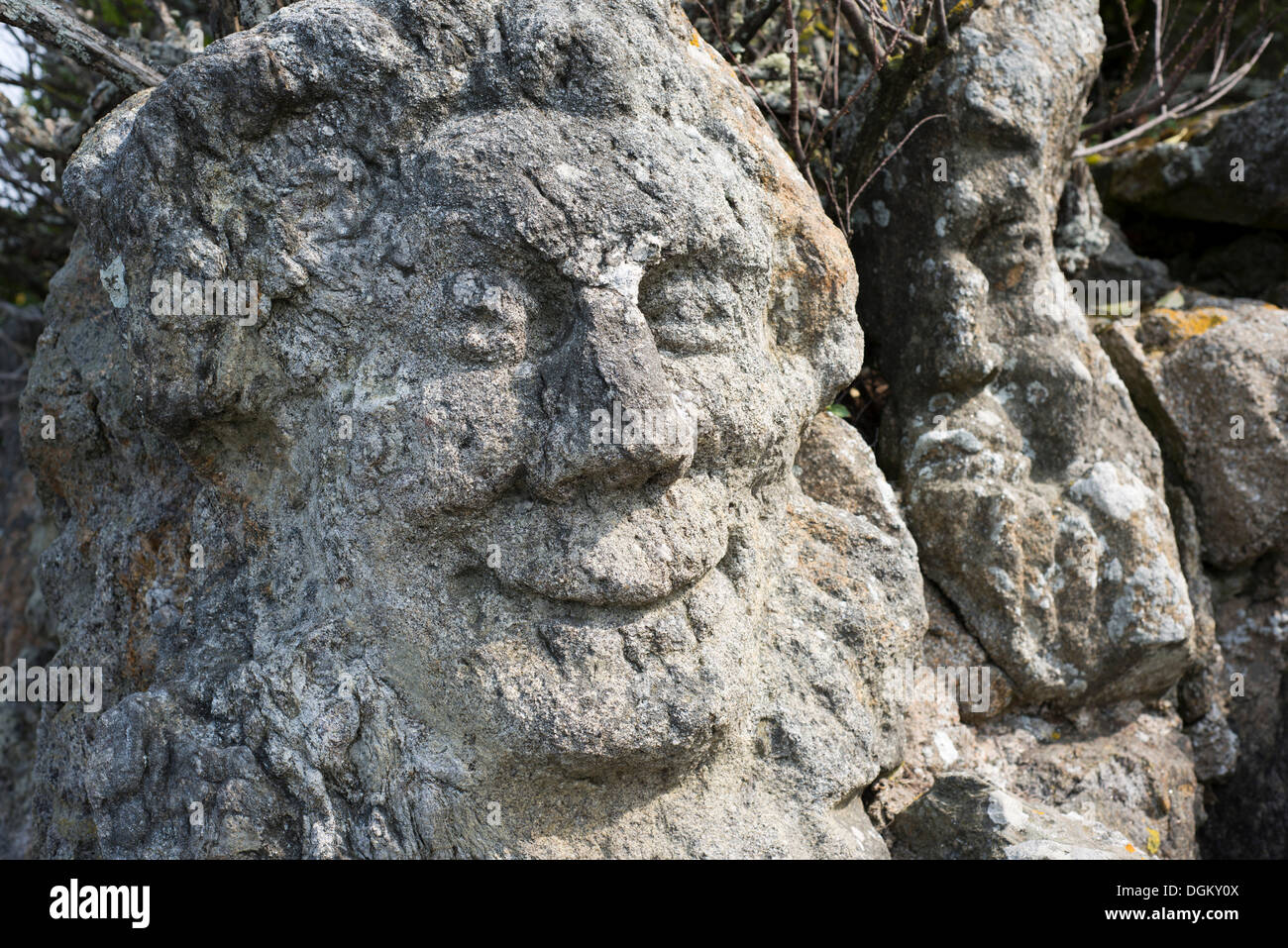 Stone head in the garden of sculpted rocks by Abbé Fouré, Rothéneuf, Brittany, France, Europe - Stock Image