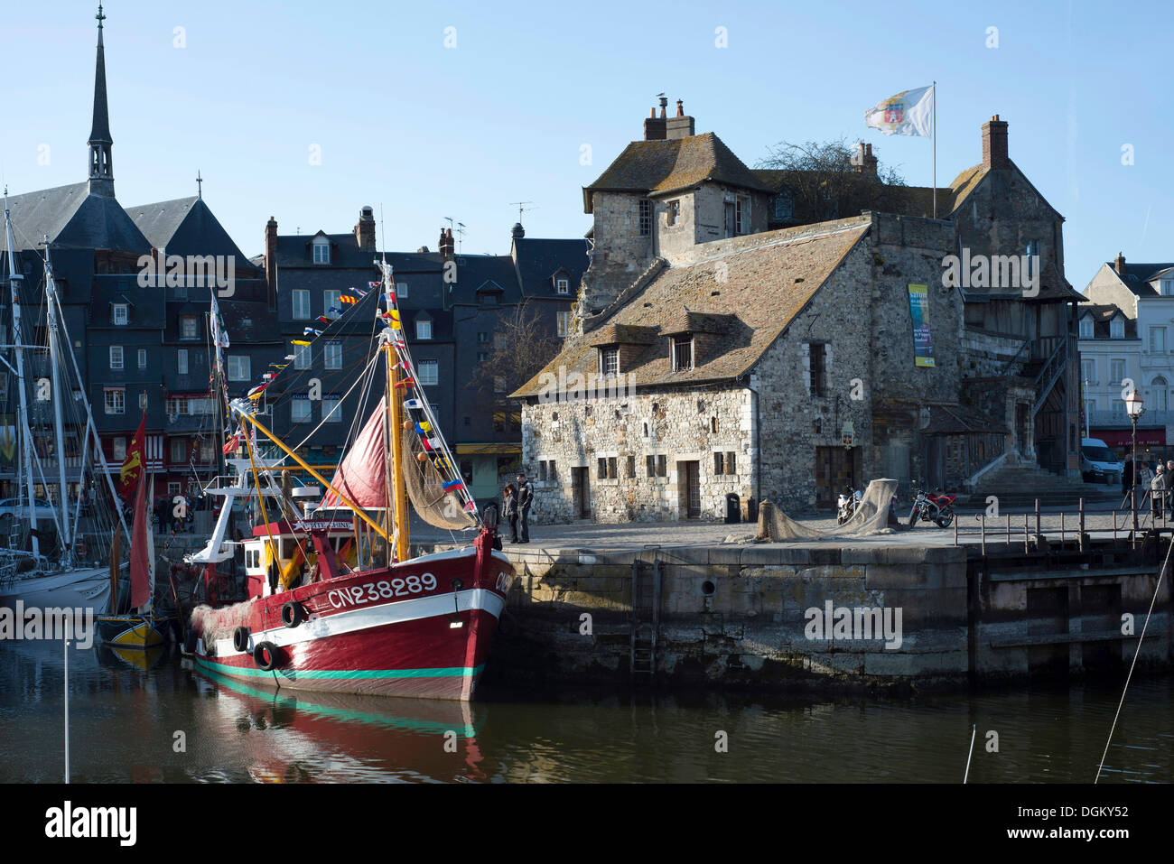 Port basin with a boat, historical city gate, Honfleur, Normandy, France, Europe - Stock Image