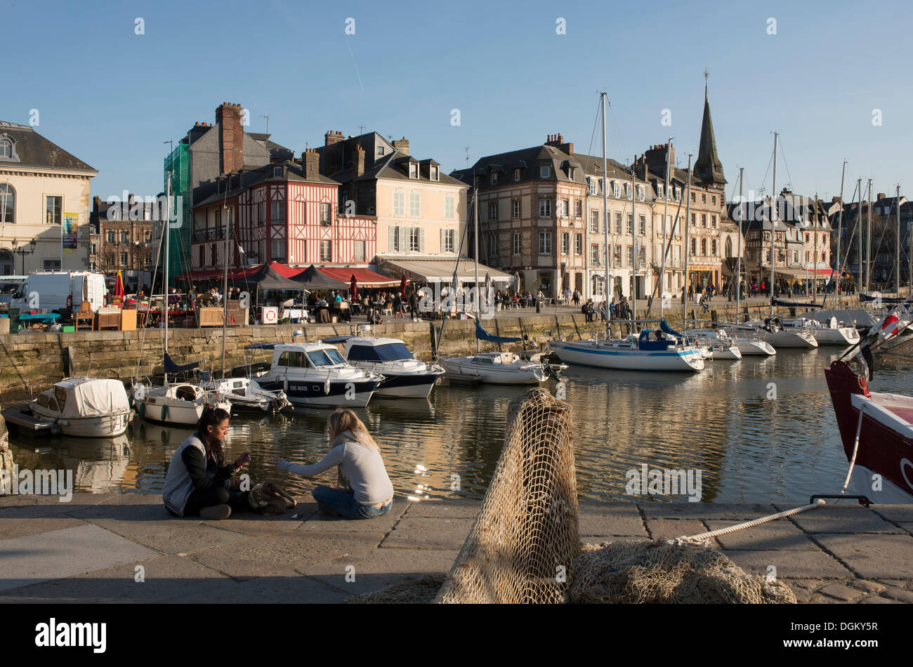 Harbour of Honfleur with row of houses at the quay, Normandy, France, Europe - Stock Image