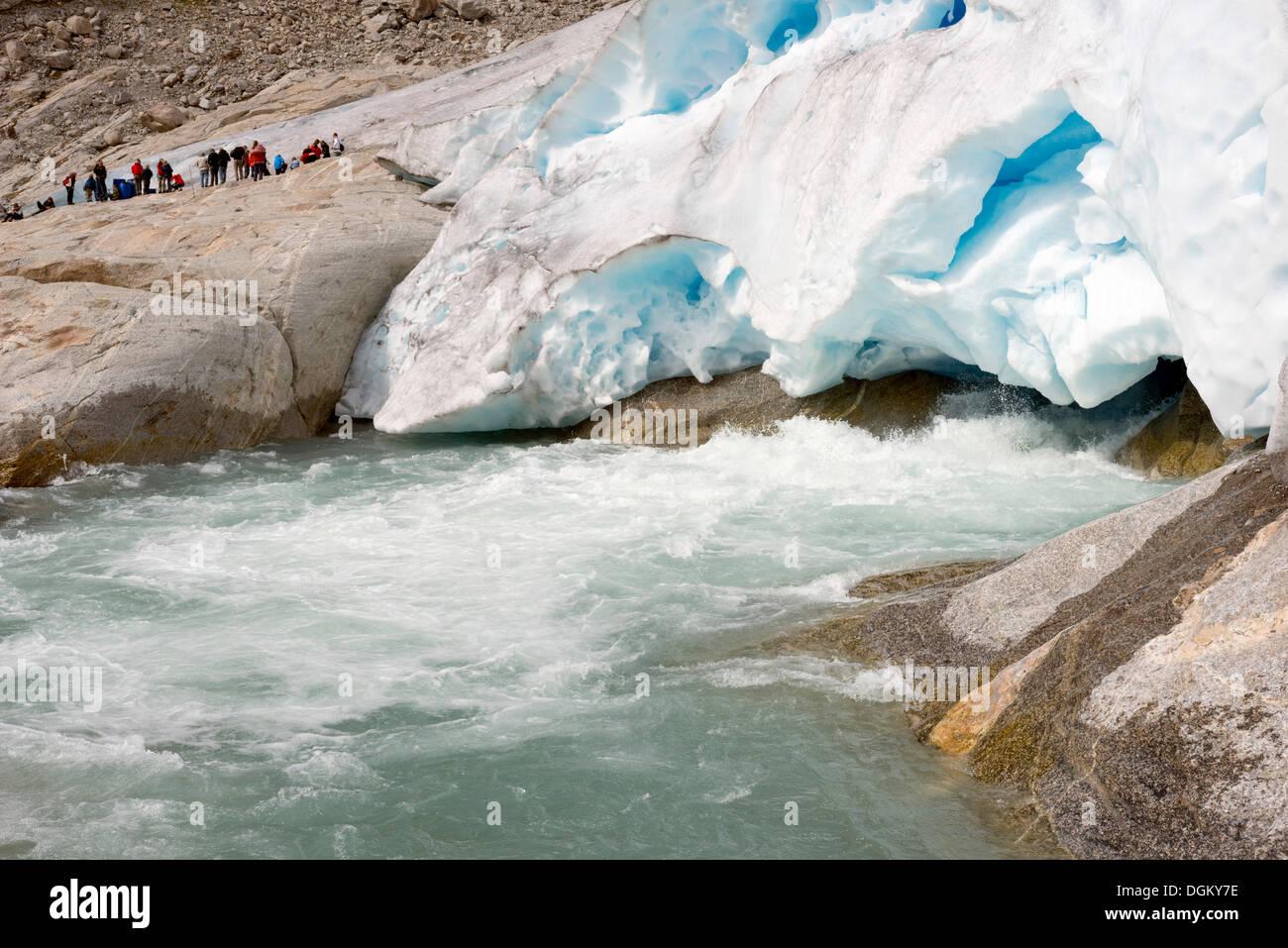 Blue ice and runoff of the glacier tongue of Nigardsbreen Glacier, Jostedal, Gletscher Jostedalsbreen, Sogn og Fjordane - Stock Image