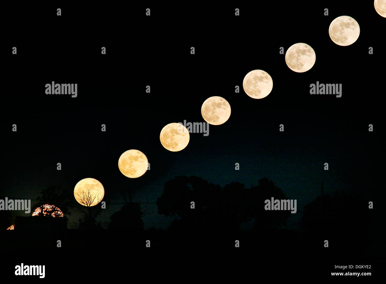 Sequence of full moon rising over a grave yard in France - Stock Image