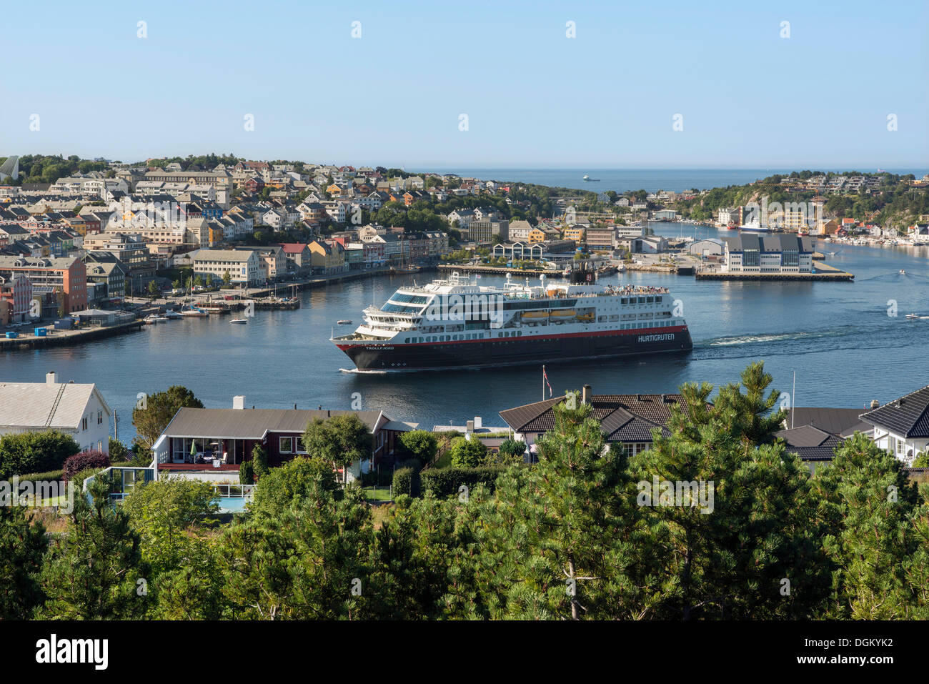 Cityscape with the harbour as a cruise ship is departing, Kristiansund, Møre og Romsdal, Western Norway, Norway - Stock Image