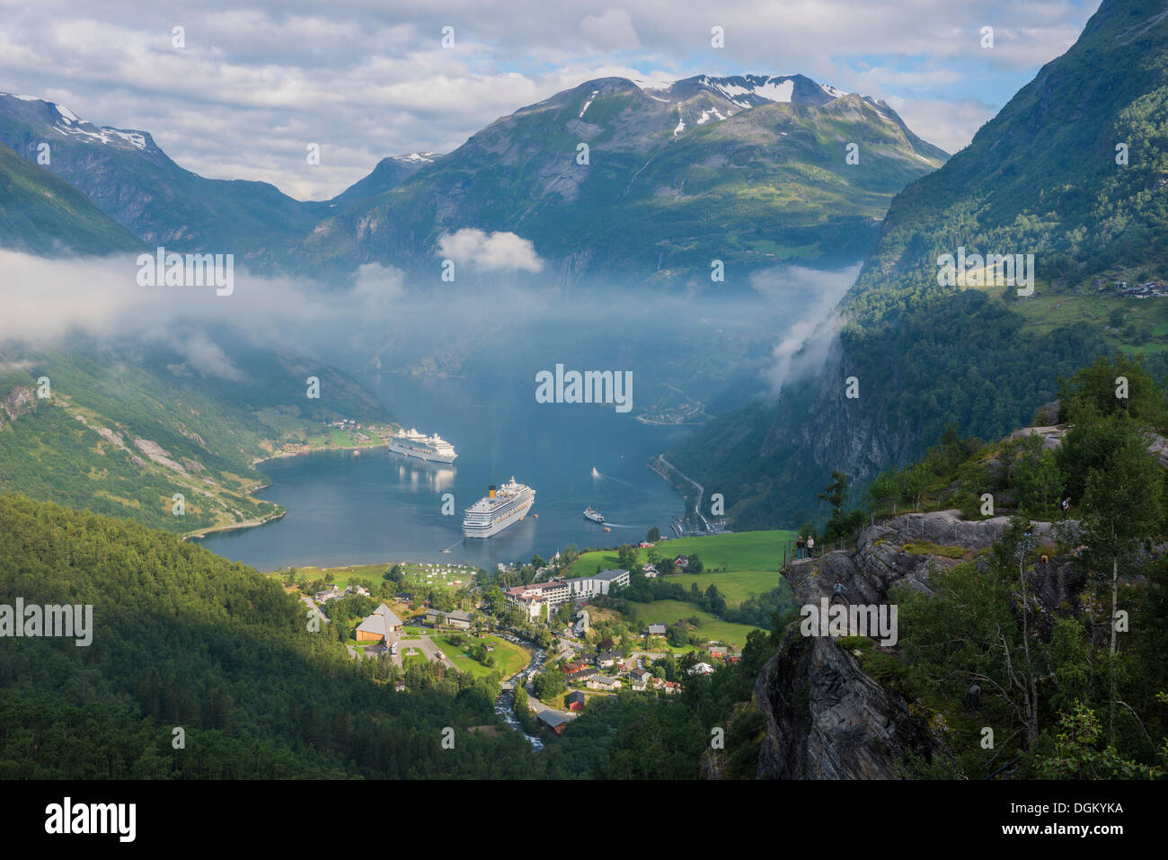 Geirangerfjord with cruise ships, view from the lookout point of Flydalsjuvet towards mountains at the rear, Geiranger - Stock Image