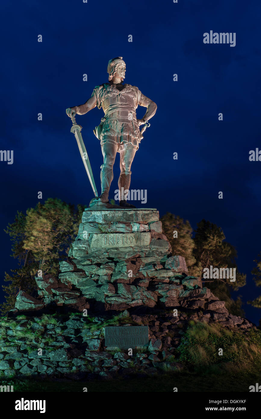 Viking Monument, bronze statue on a stone plinth in the spotlight, Kristiansand, Vest-Agder, Southern Norway, Norway - Stock Image