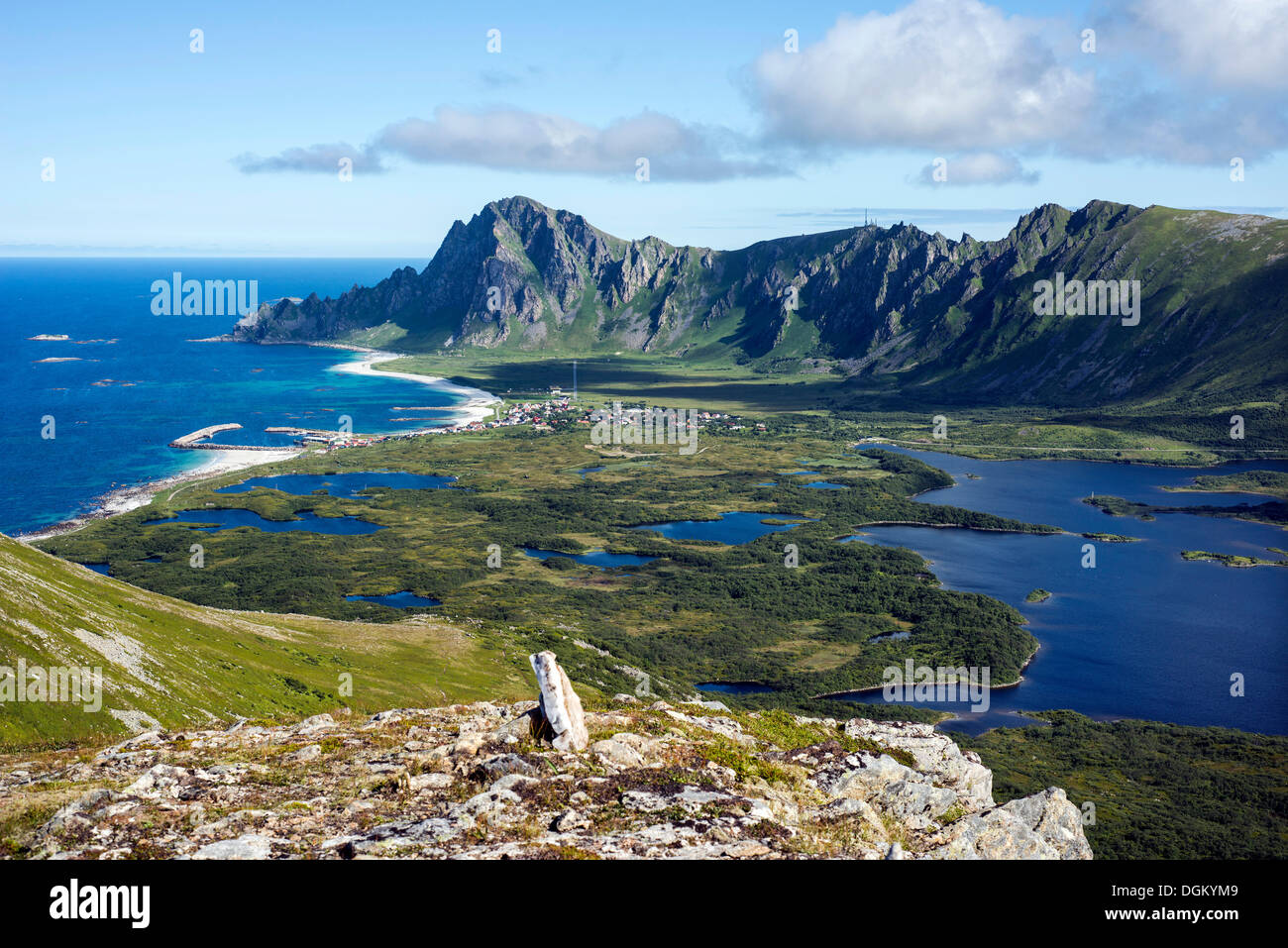 Glacial moraine and the village of Bleik with ponds and lakes, mountain range at back, Insel Andoya/ Atlantikküste - Stock Image