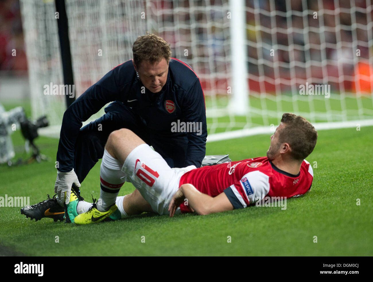 London, UK. 22nd Oct, 2013. Arsenal's Jack Wilshere gets medical treatment during the Champions League group F soccer match between Arsenal FC and Borussia Dortmund at the Emirates Stadium in London, UK, 22 October 2013. Photo: Bernd Thissen/dpa/Alamy Live News - Stock Image
