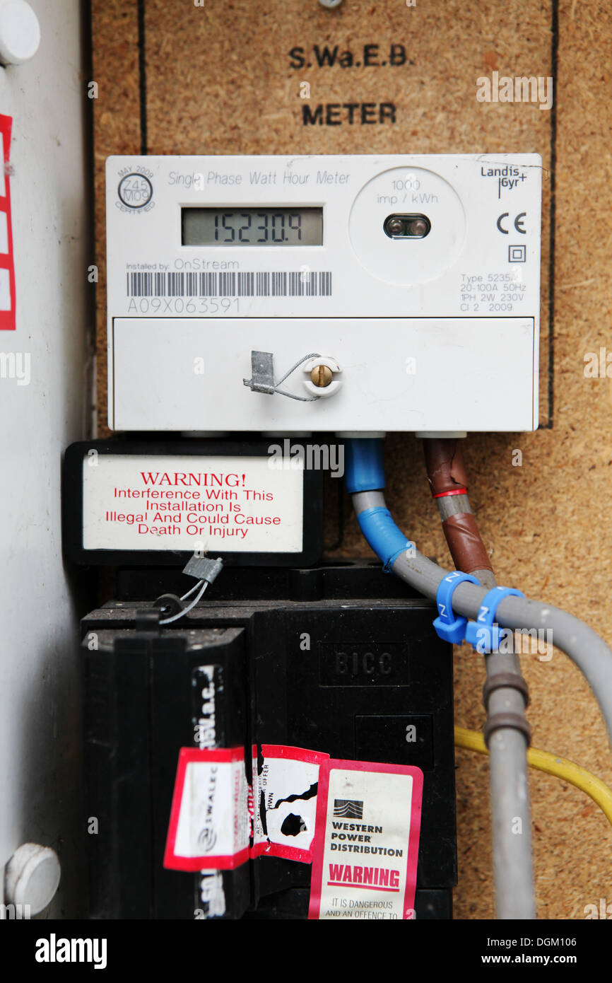 electricity meter with digital dial numbers domestic external home fuel  heating rising cost utility expensive