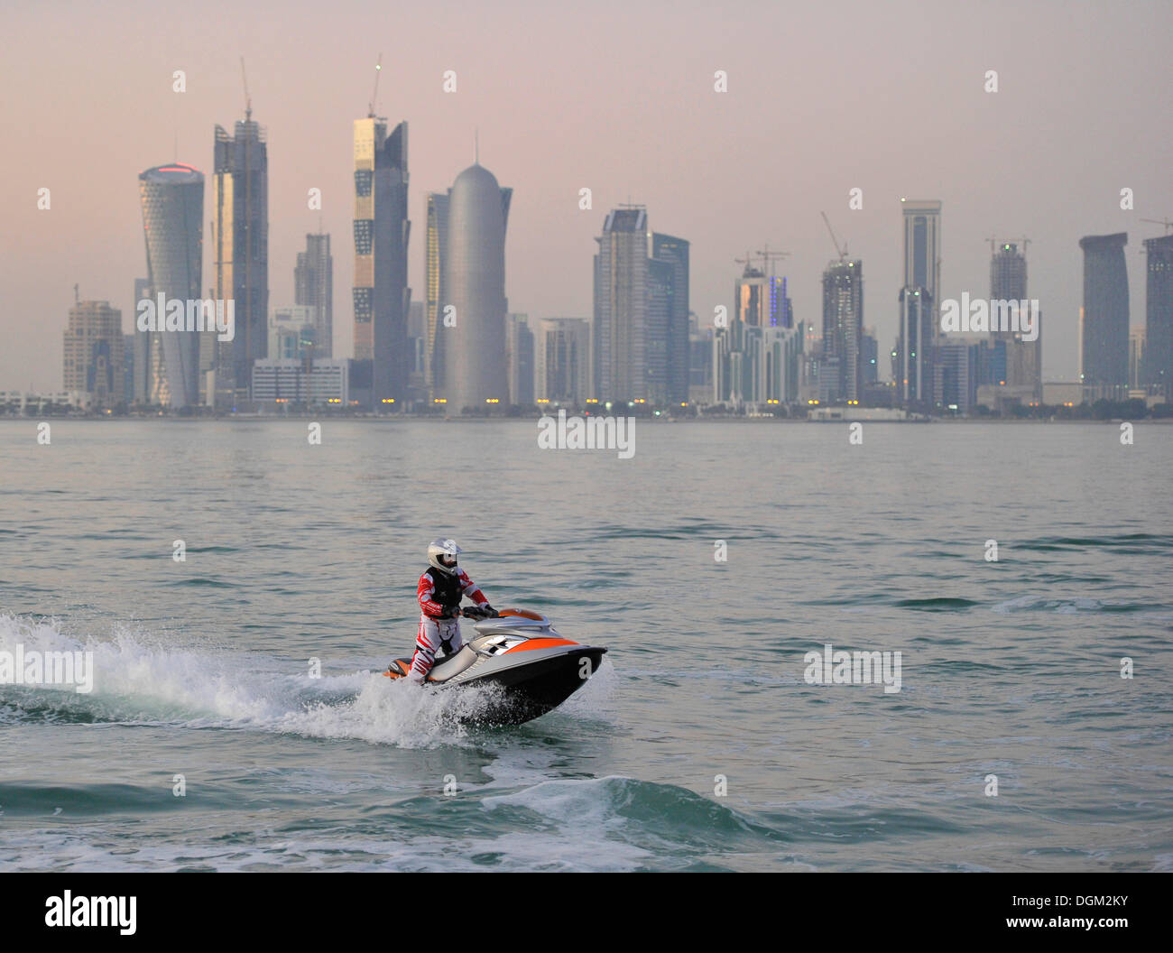 Jet-skiing, jetboat, personal watercraft in front of the skyline of Doha, Qatar, Persian Gulf, Middle East, Asia - Stock Image