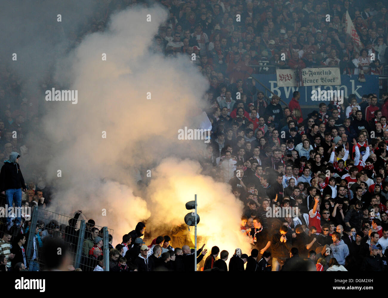 Vandalisers igniting fireworks, smoke bombs, flares, pyros, in the VfB Stuttgart fanblock, Mercedes-Benz Arena, Stuttgart - Stock Image