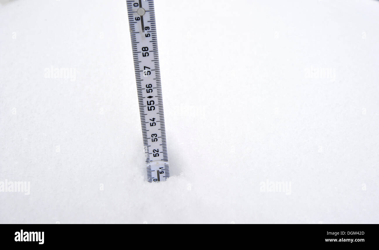 Yard stick in the snow measuring the snow depth - Stock Image