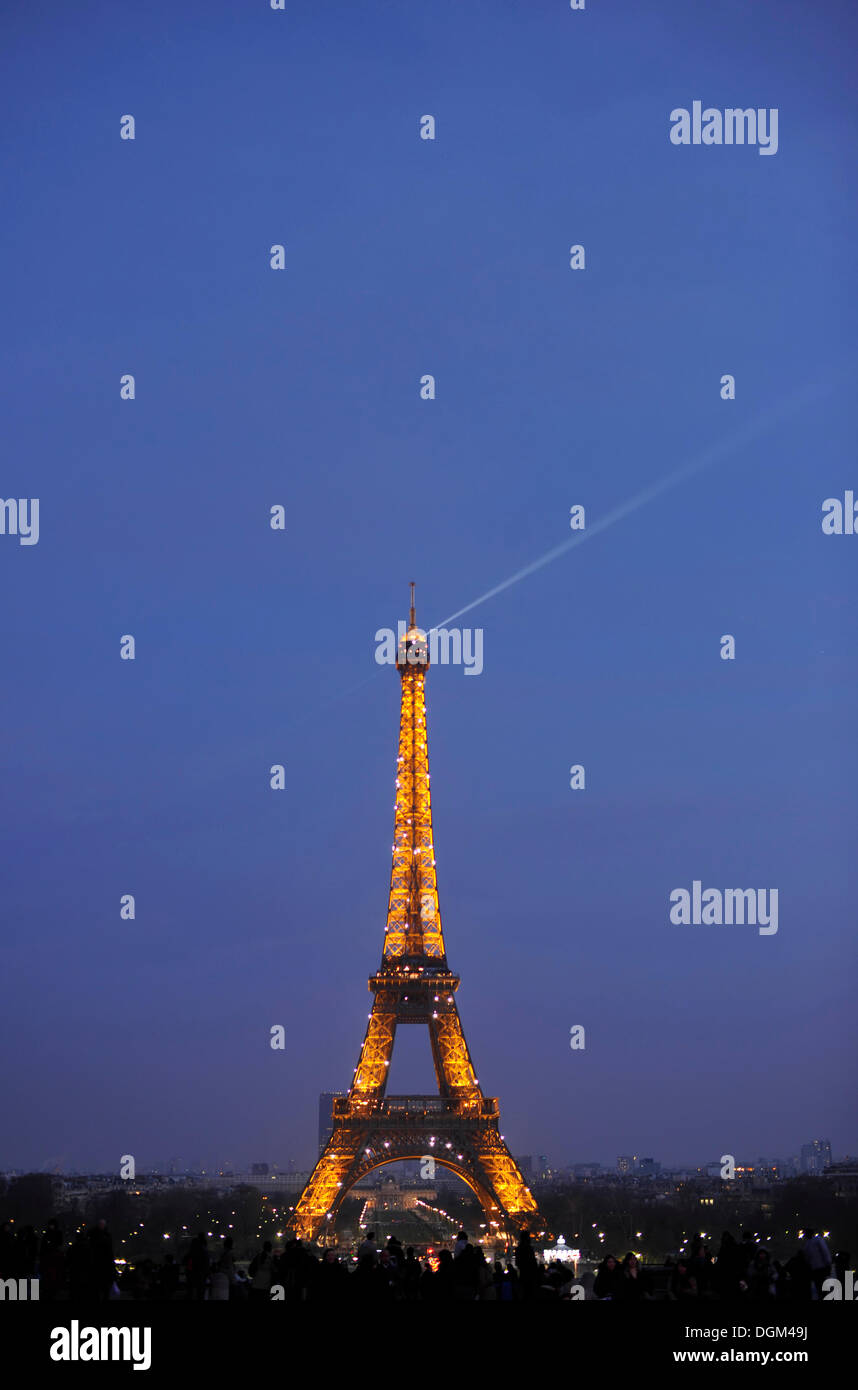 Tourists in front of the Tour Eiffel or the Eiffel Tower, Paris, France, Europe - Stock Image
