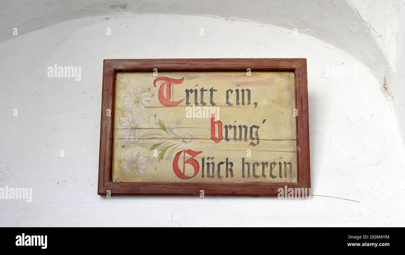 Entrance sign, Tritt ein, bring' Glueck herein, German for Come in and bring good fortune, Museum House, Loisium Stock Photo