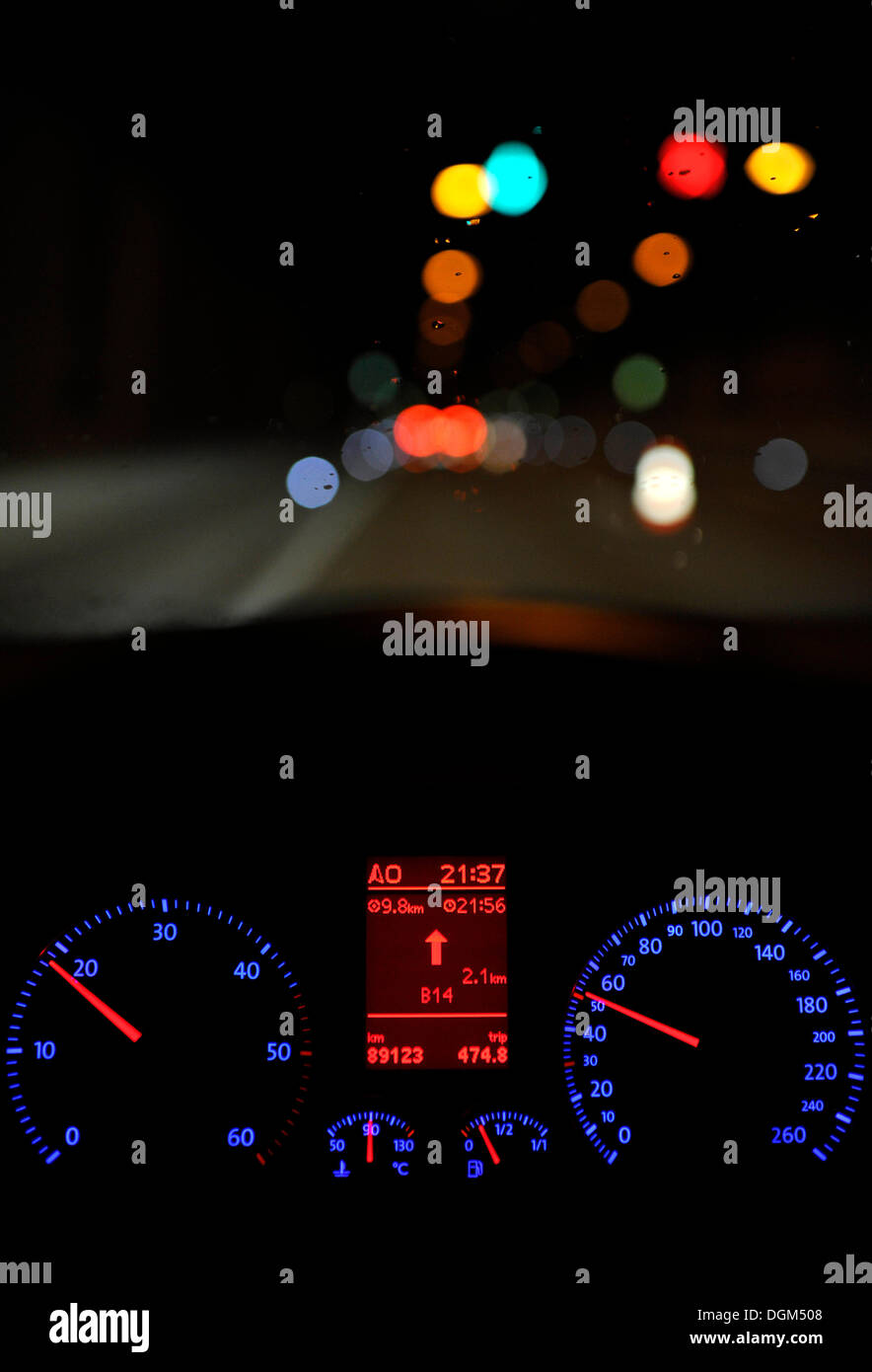 Poor visibility in rain, illuminated speedometer with navigation display, driving VW Golf - Stock Image