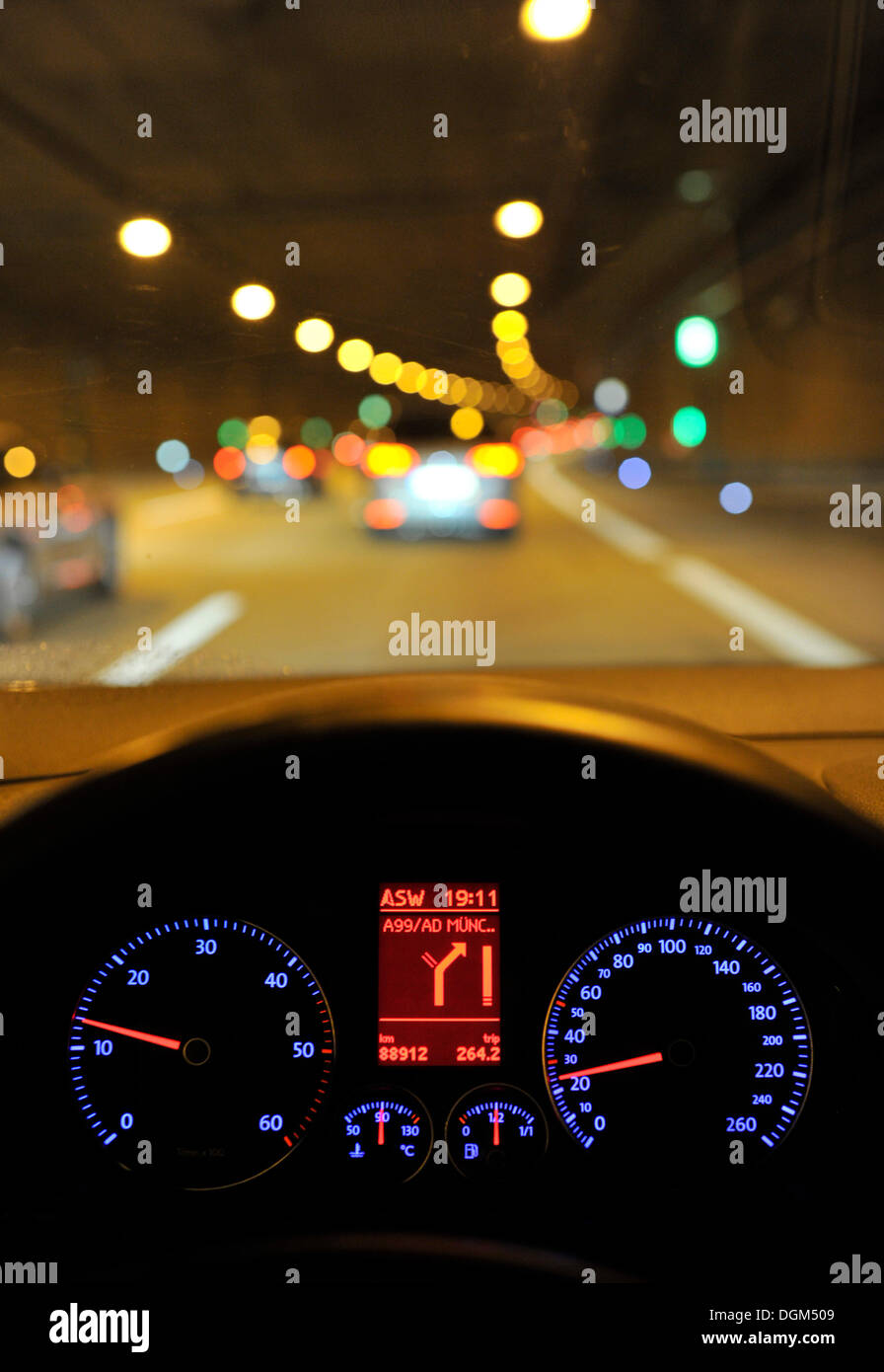 Night, poor visibility in a tunnel, tachometer with navigation display, VW Golf, illuminated, while driving - Stock Image