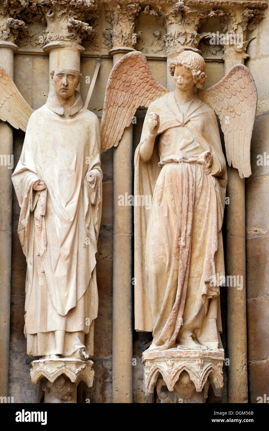 "Statues, on the right the ""friendly angel"", left portal, west façade, Cathedral of Notre-Dame, Unesco World Heritage Stock Photo"