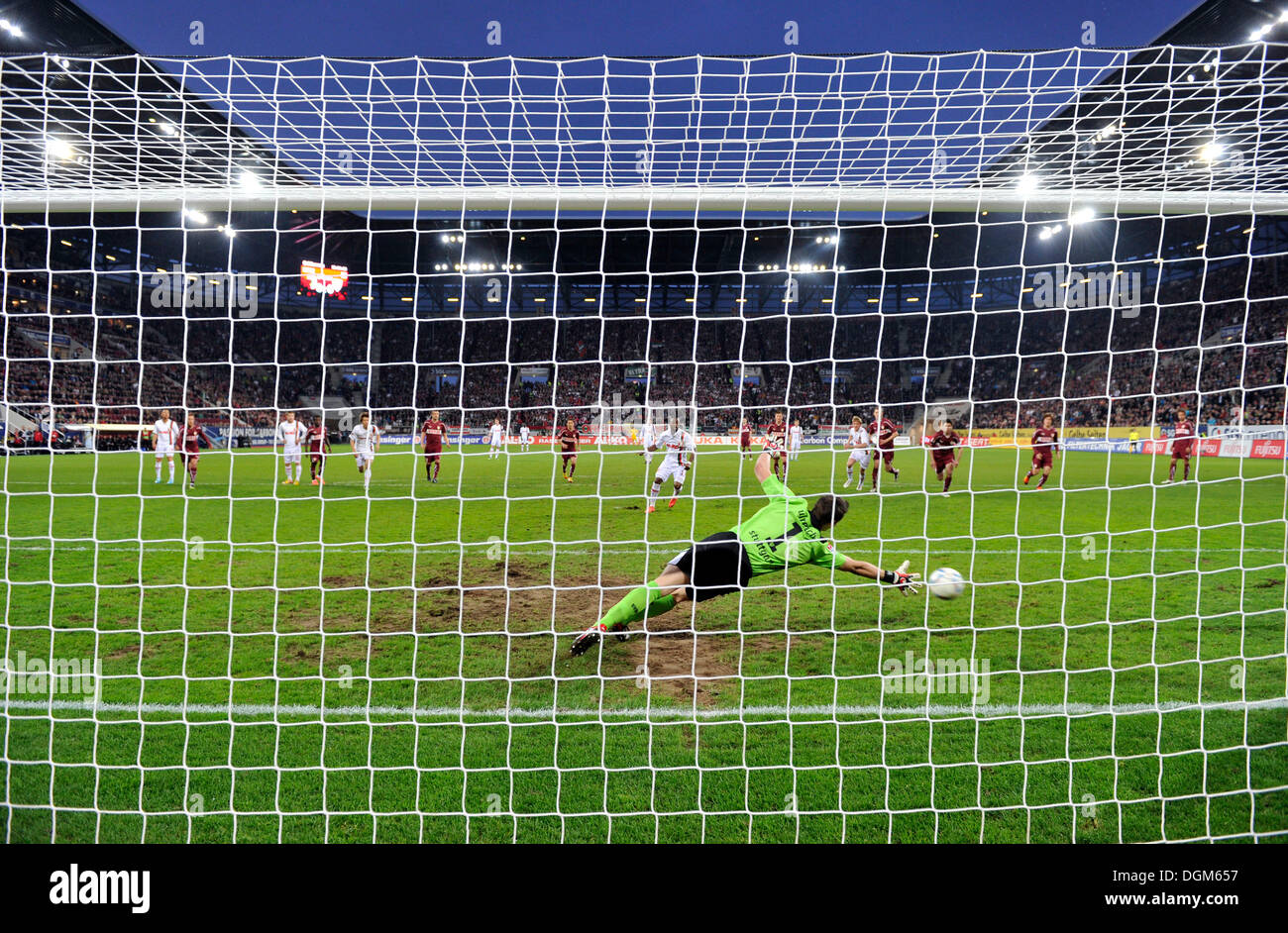 Camera shot from behind the goal, penalty to 1:0 by Nando Rafael, FC Augsburg, against the goalkeeper Sven Ulreich - Stock Image