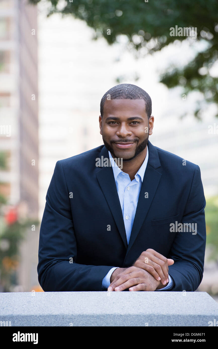 Summer. A man in a blue jacket and open necked shirt. - Stock Image