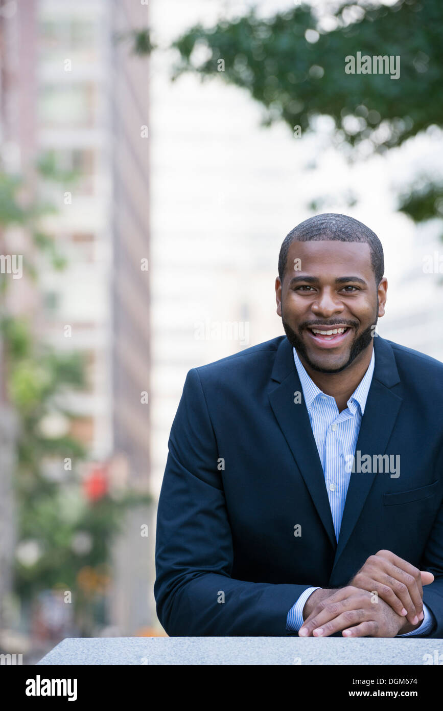 Summer. A man in a blue jacket and open necked shirt. Stock Photo