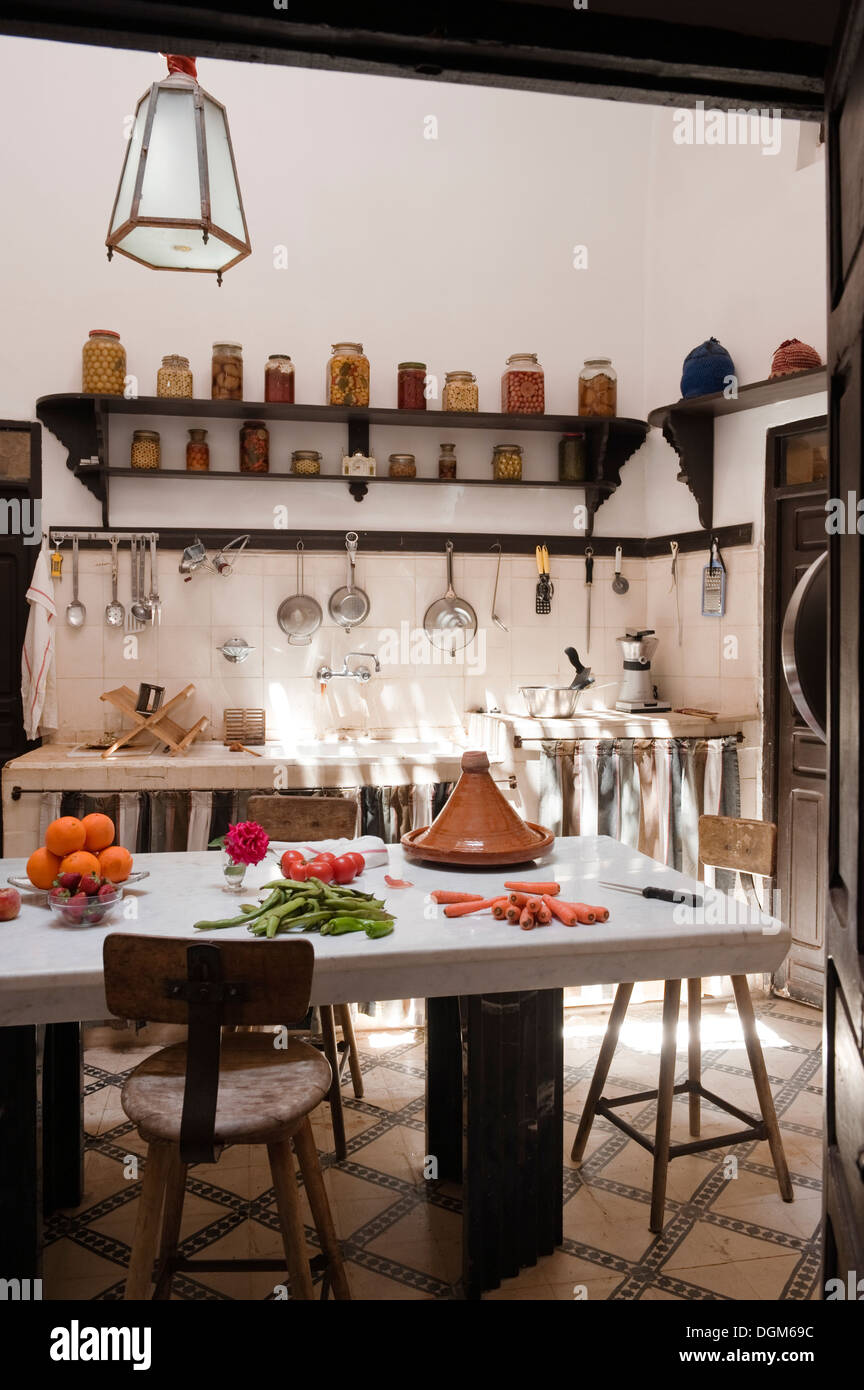 Moroccan Kitchen With Dark Wood Shelving, Hanging Pans And Utensils