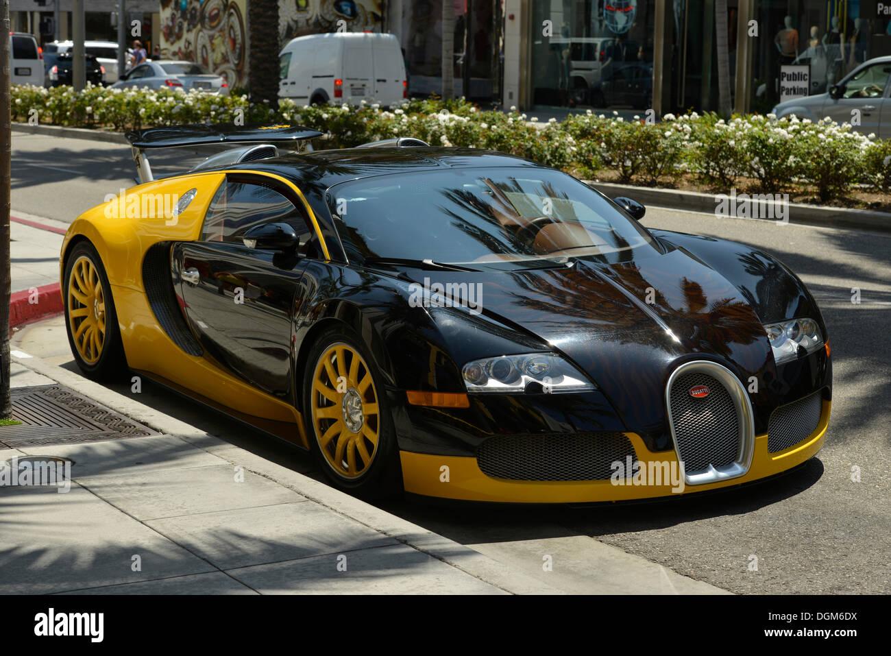 The 1.7 million dollar Bijan Bugatti Veyron Grand Sport, single copy, homage to Bijan Pakzad, parked outside his store 'House of - Stock Image