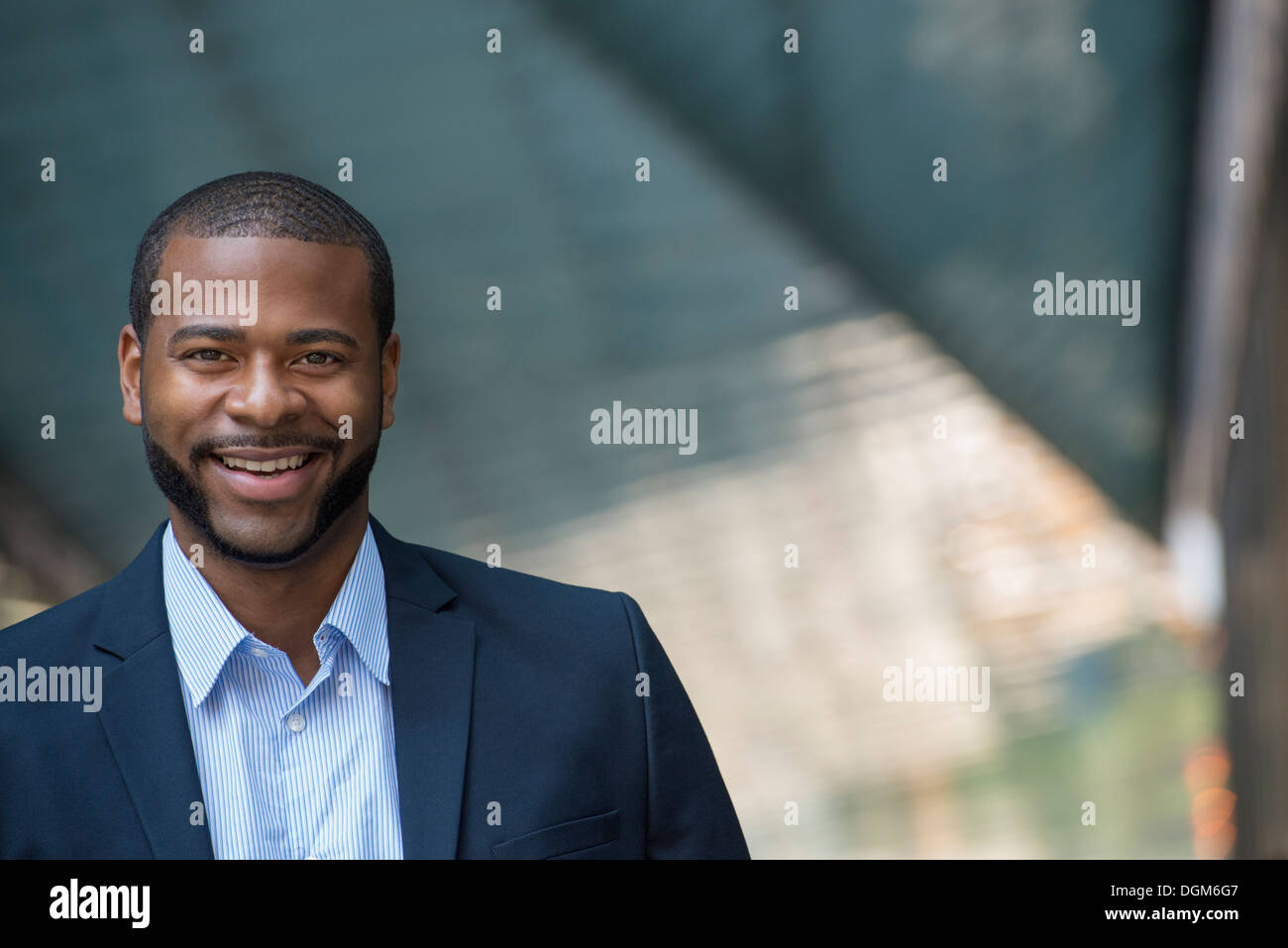 Summer. A man in a blue jacket and open necked shirt. Smiling. Stock Photo