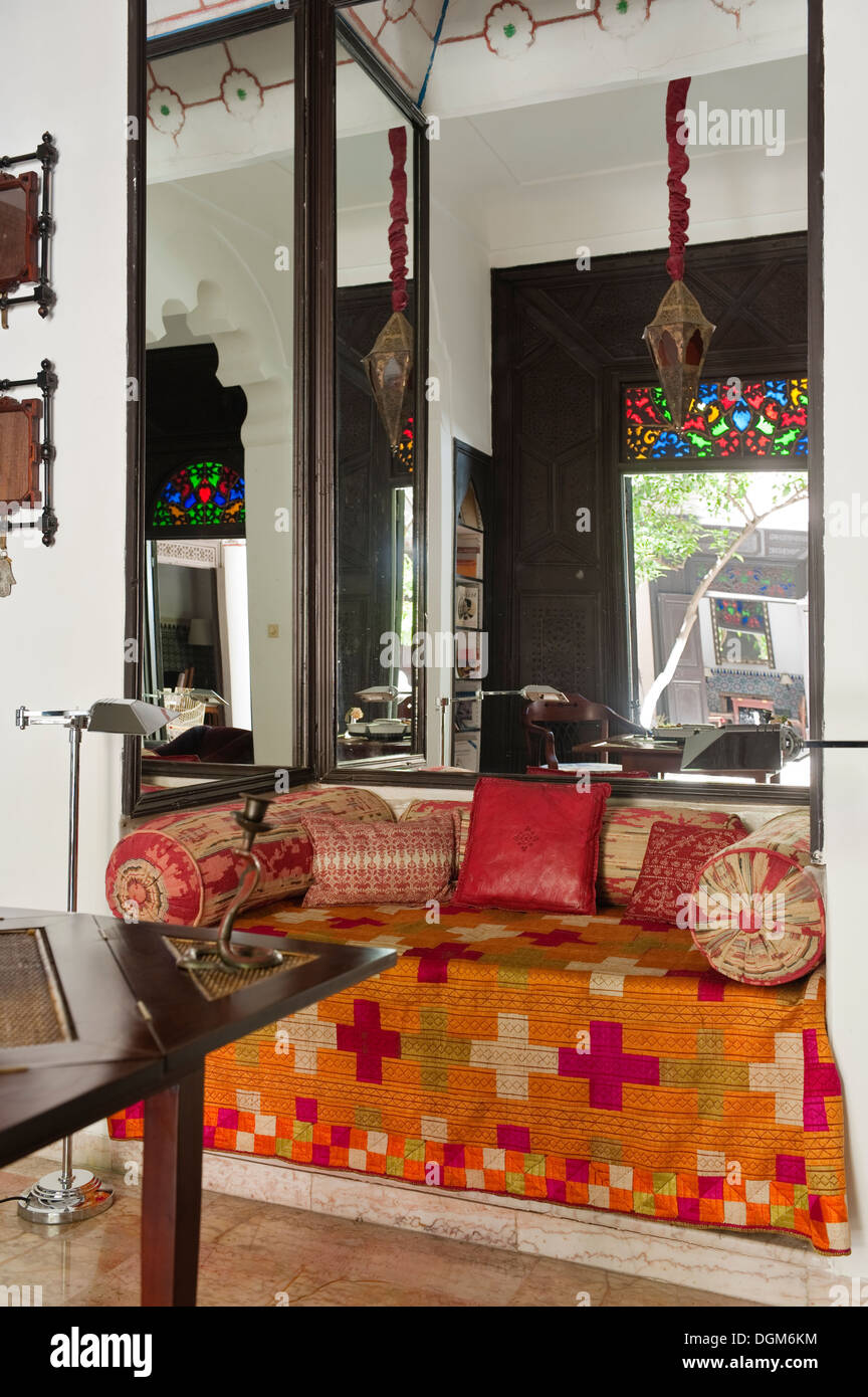 Beautiful hand-crafted Moroccan bed spread on daybed - Marrakesh, Morocco - Stock Image