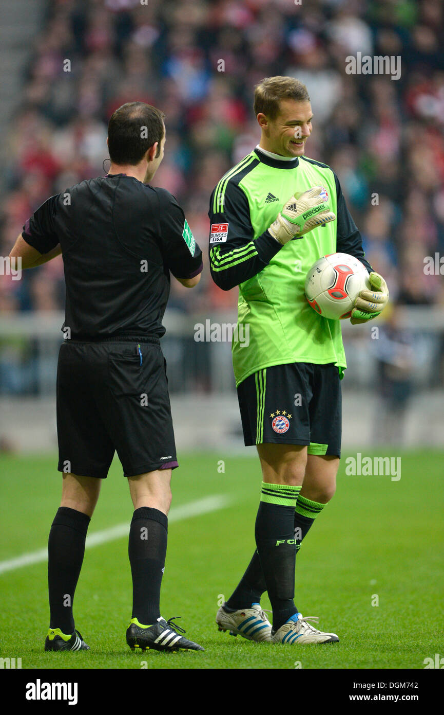 Goalkeeper Manuel Neuer, FC Bayern Munich, right, getting on with referee Marco Fritz, left, Allianz Arena, Munich, Bavaria - Stock Image