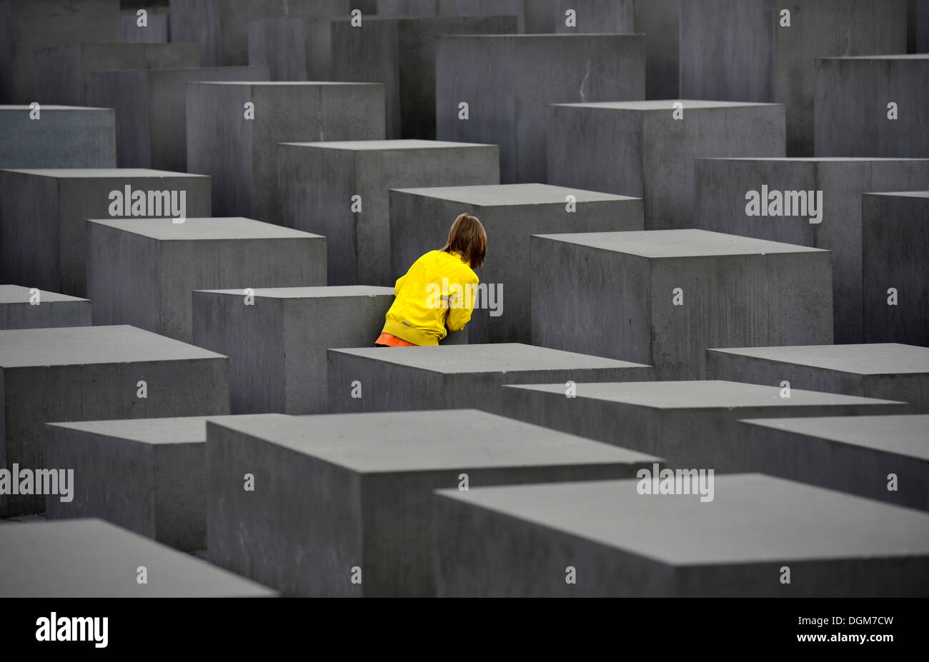 Memorial to the Murdered Jews of Europe, child playing hide and seek at the Holocaust Memorial designed by architect Peter - Stock Image