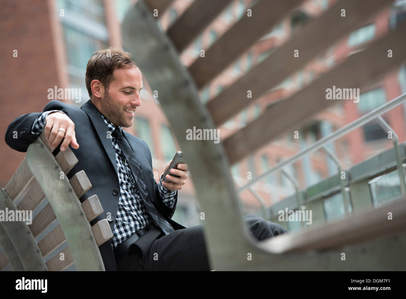 Business people. A man in a suit, sitting on a bench. Stock Photo