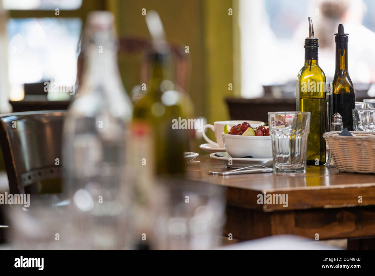 Interior of a city coffee shop or cafe. Tables laid for meals. - Stock Image