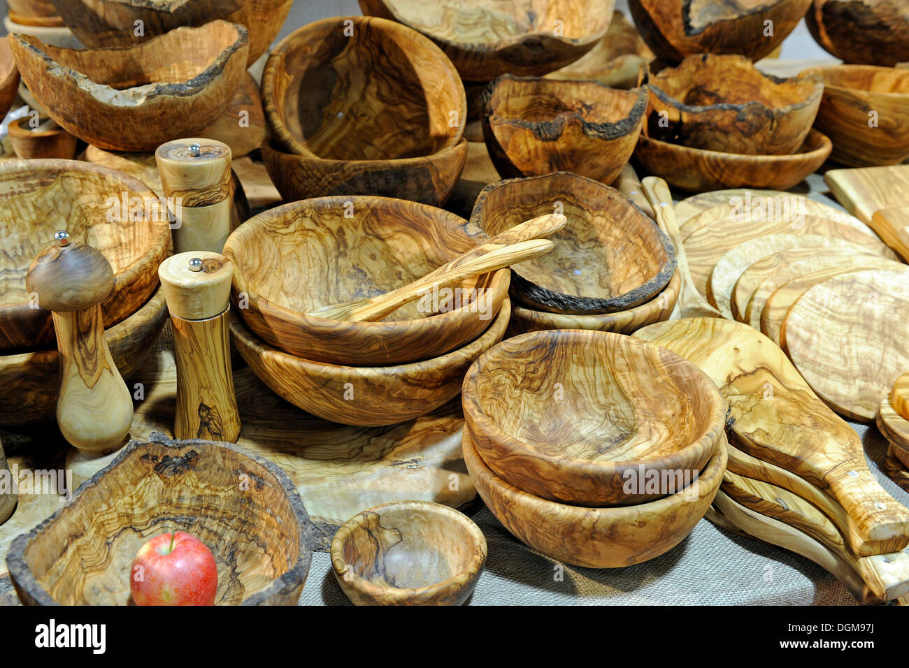 Various kitchen utensils made of olive wood - Stock Image