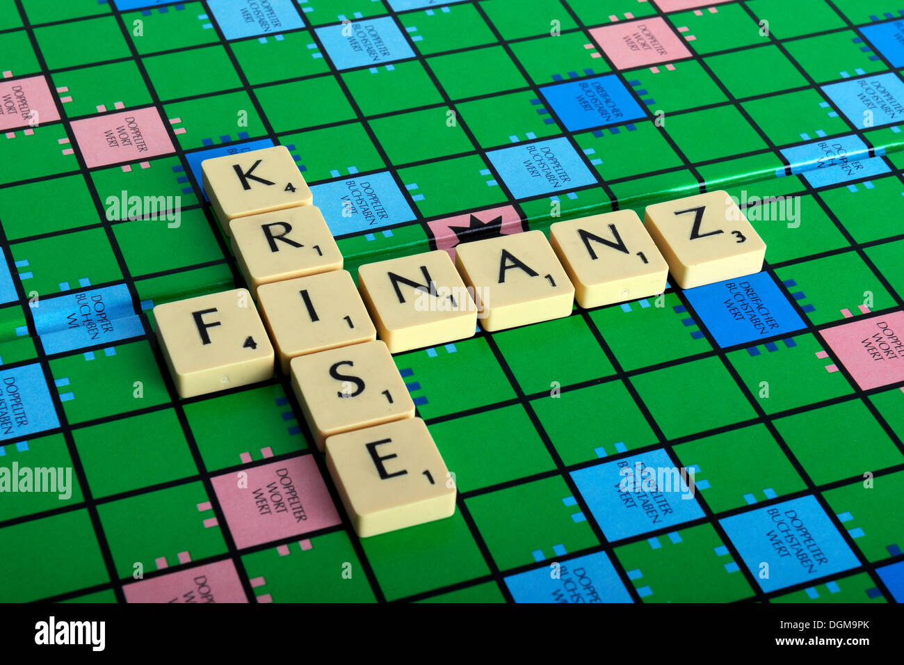 Scrabble letters forming the words Finanz and Krise, German for financial crisis - Stock Image