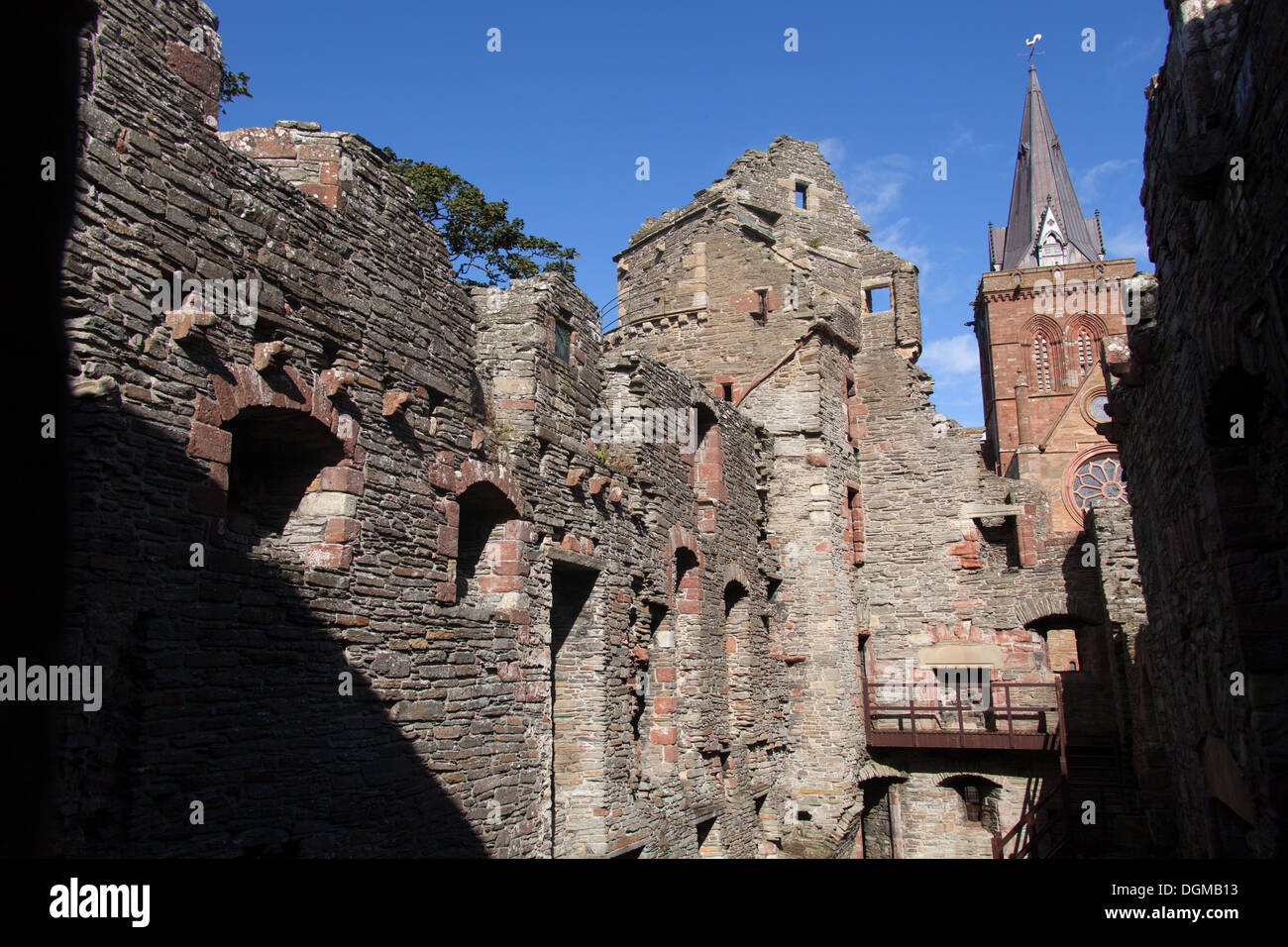 Islands of Orkney, Scotland. Kirkwall's Bishops Palace, with the spire of St Magnus Cathedral in the background. Stock Photo