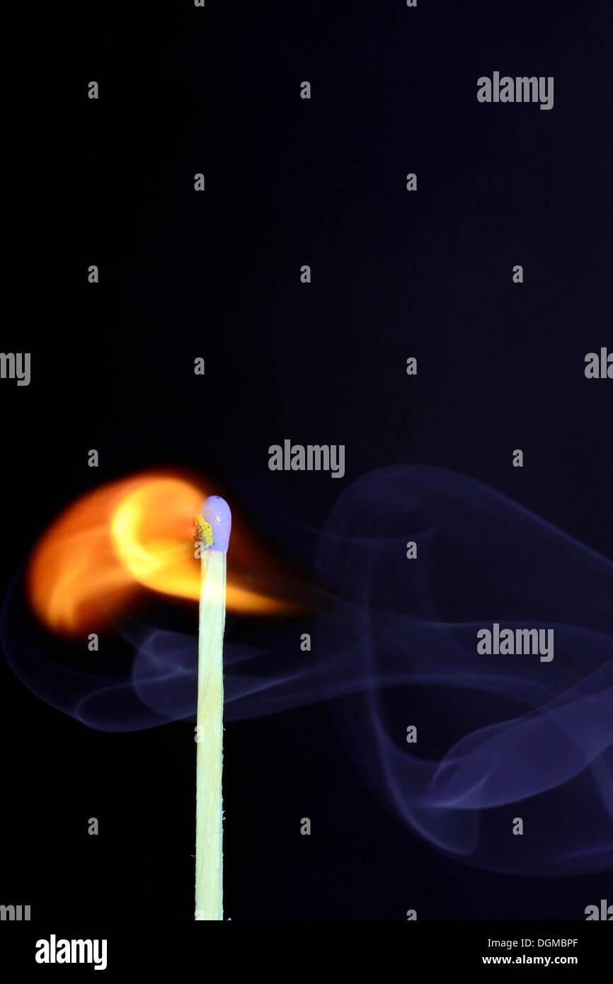 Match being lit, blue smoke, Germany - Stock Image