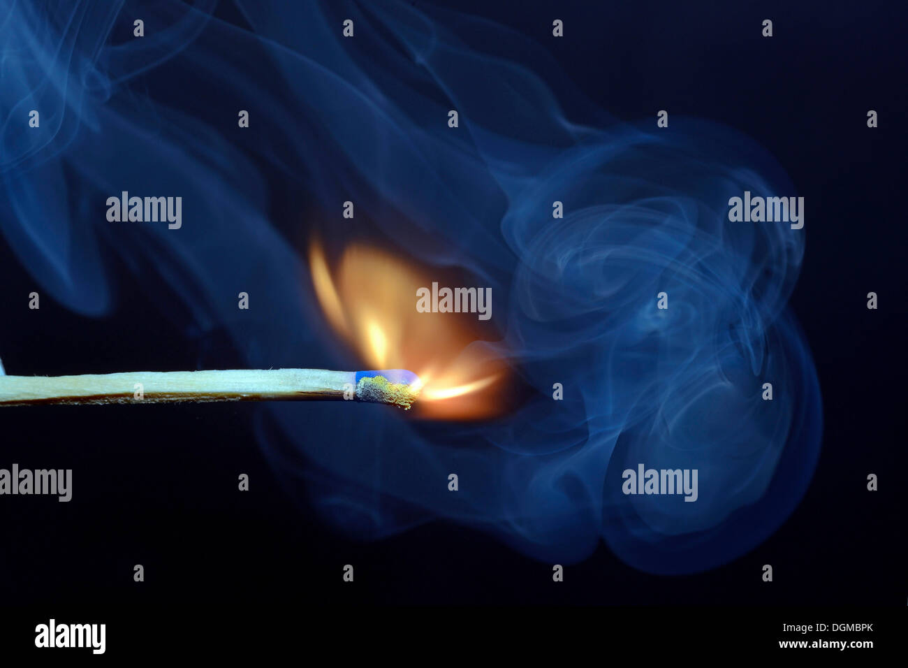 Match being lit, blue smoke - Stock Image