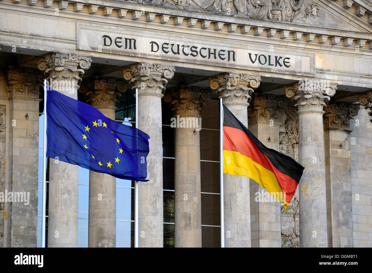 Flags of the European Union and Germany in front of the main gable of the Reichstag Building, Bundestag, Berlin, Germany - Stock Image