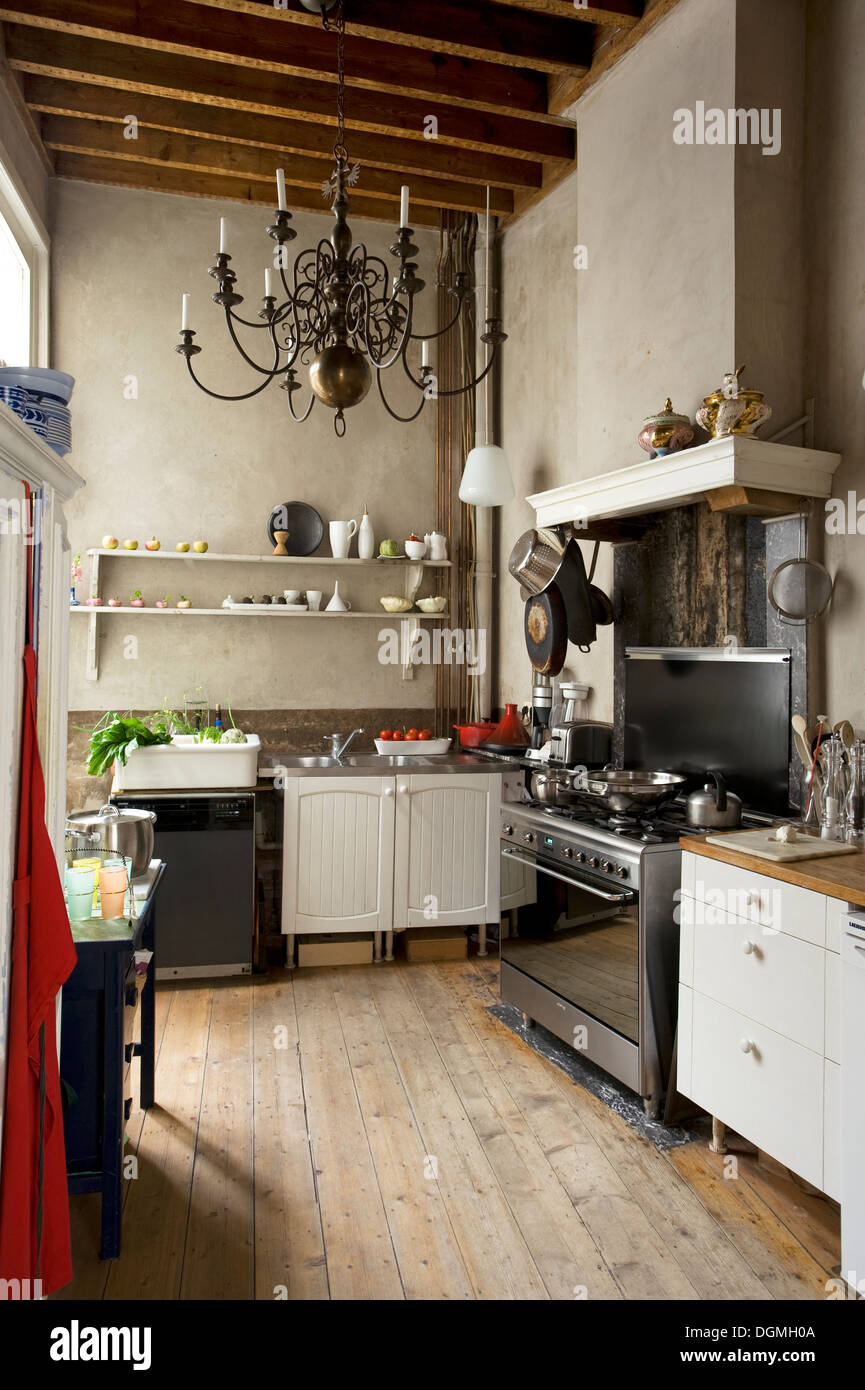 Old fashioned kitchen with lime washed walls in mid19th century