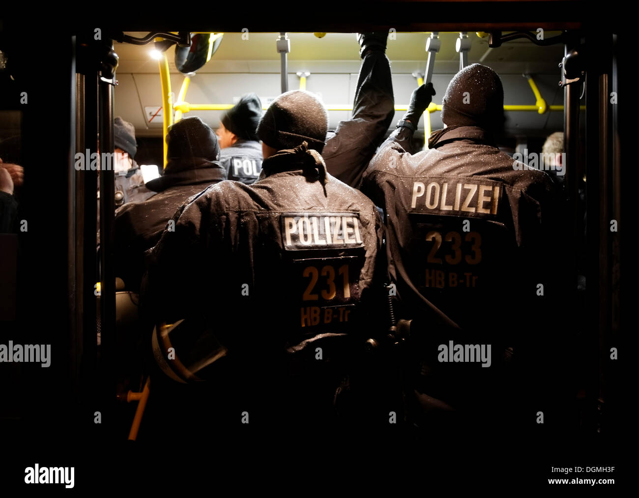 Riot police riding in public service vehicle of the Stuttgarter Strassenbahnen to a demonstration against Stuttgart 21 in - Stock Image