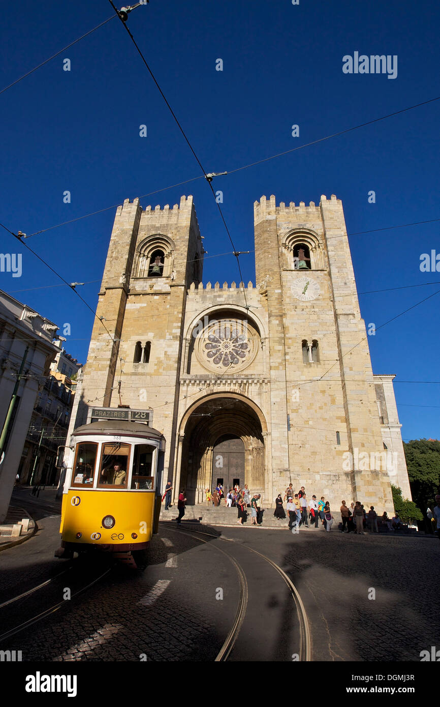 Yellow tram in front of the Sé Cathedral or Catedral Sé Patriarcal, Lisbon, Portugal, Europe Stock Photo