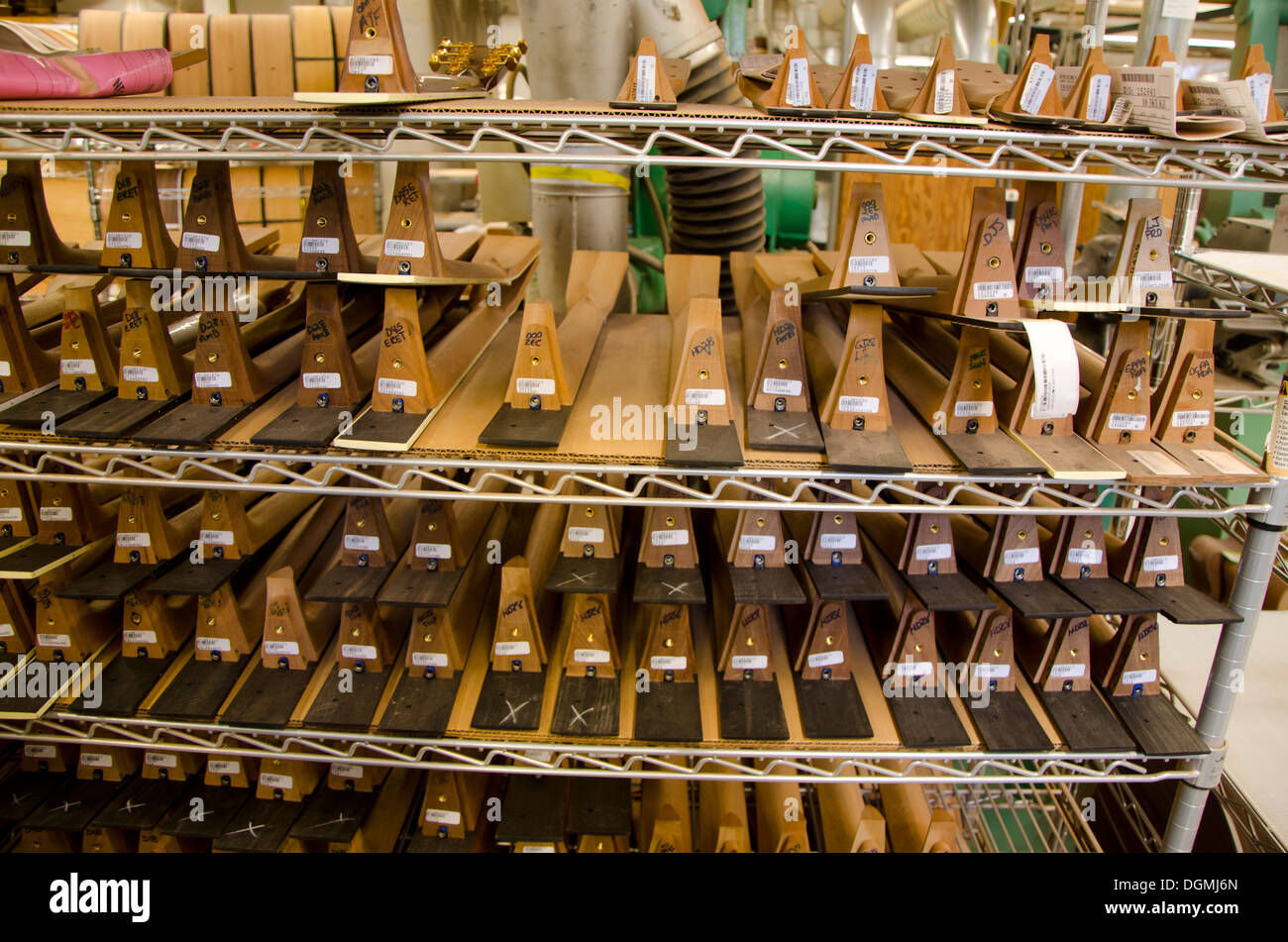 Stacked guitar necks during production process at Martin guitars factory  in Nazareth, Pennsylvania, USA - Stock Image